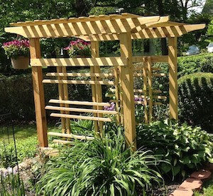 photo of a backyard garden arbor made using pressure treated pine