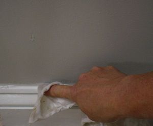 photo demonstrating how to smooth out a bead of caulk