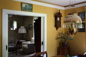 photo vintage dining room with yellow walls, a white ceiling, and white trim