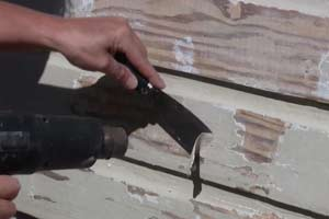 photo stripping siding paint with a heat gun