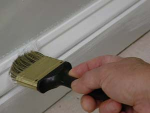 photo painting a baseboard next to a wall