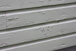 photo peeling paint on house dutch lap siding siding