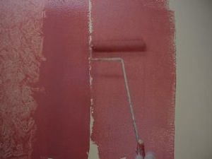 photo demonstrating how to roll painting glaze onto a wall