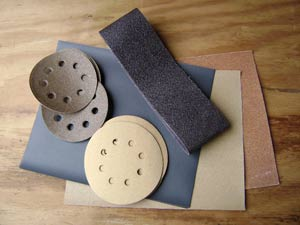 photo of various types of sandpaper and abrasives