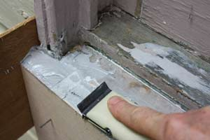 shaping hardened epoxy filler in a windowsill
