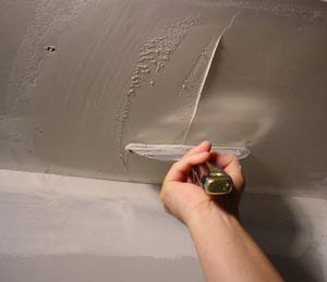 photo of skim coating a drywall ceiling patch