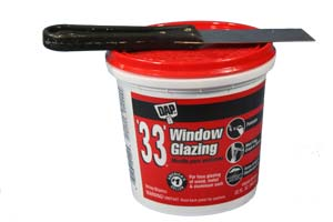 photo of a can of dap brand window glazing