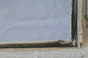 photo of the exterior of a wooden window sash and glass pane