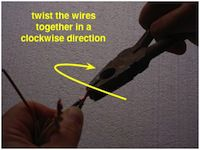 photo twisting clockwise to splice wires together